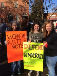 """Women holding a sign saying, """"Women Matter, Vote"""""""