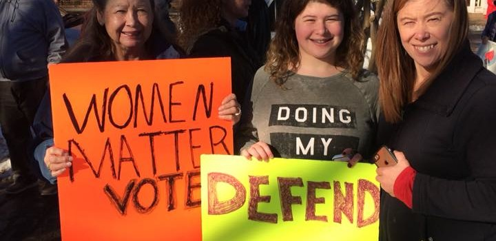 "Women holding a sign saying, ""Women Matter, Vote"""
